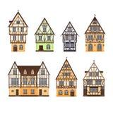 El sistema de la mitad coloreada aislada enmaderó edificios en el fondo blanco Colección de fachadas planas de casas que enmarcan