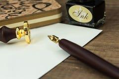 El sistema de la tinta usado para escribir letras con el sello sella Fotos de archivo libres de regalías