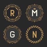 El sistema de plantillas elegantes del emblema y del logotipo del monograma del vintage Imágenes de archivo libres de regalías