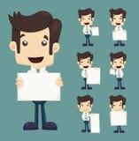 El sistema del hombre de negocios que lleva a cabo caracteres en blanco de las notas presenta Fotos de archivo