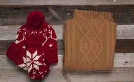 El sistema del invierno viste el suéter y el casquillo Fotos de archivo libres de regalías