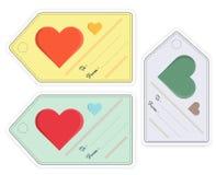 El sistema del regalo de la Navidad marca con etiqueta en diversos colores con los corazones Fotografía de archivo libre de regalías
