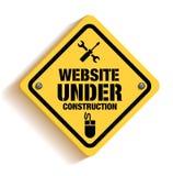 El sitio web bajo construcción firma adentro Backgroun blanco Imagen de archivo