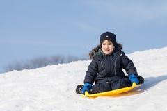 El Sledding en invierno Imagen de archivo