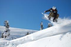 Salto de la snowboard Imagen de archivo libre de regalías