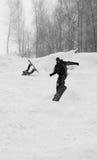 El Snowboarder salta y desgracia Imágenes de archivo libres de regalías