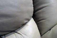 El sofá de cuero amortigua cierre encima de la foto imagen de archivo libre de regalías