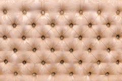 El sofá detrás tapizó en tela como fondo y textura fotografía de archivo