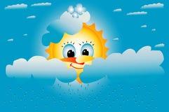 el sol amarillo sonríe en las nubes Imagen de archivo libre de regalías