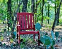 El solitario rojo de la silla Foto de archivo libre de regalías
