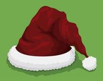 El sombrero de Papá Noel en el fondo verde, ejemplo del vector Imagen de archivo