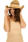 El sombrero occidental del vestido sin tirantes del moreno de la mujer mira abajo Imagen de archivo libre de regalías
