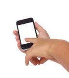 El sostenerse y el señalar en el teléfono elegante moderno Fotos de archivo