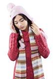 El suéter que lleva de la muchacha y tiene dolor de cabeza Foto de archivo