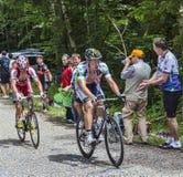 El subir de los ciclistas Imagen de archivo libre de regalías
