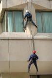 El subir de los hombres Foto de archivo libre de regalías
