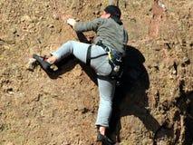 El subir de montaña Foto de archivo