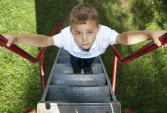 El subir del muchacho Fotografía de archivo
