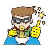 El super héroe come los tallarines Foto de archivo libre de regalías