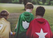 El super héroe embroma concepto de la diversión de las aspiraciones al aire libre imagen de archivo libre de regalías