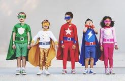 El super héroe embroma concepto juguetón de la diversión de la imaginación de la aspiración Fotos de archivo libres de regalías