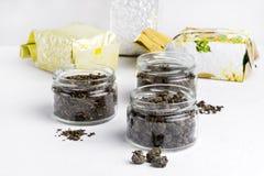 El té verde de Oolong de las bolas de té verde con té verde del loto con variedad del jengibre de té verde en vidrio sacude el te Imágenes de archivo libres de regalías