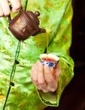 El té vertido mujer Imagenes de archivo