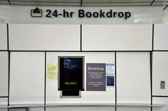 El tablero de biblioteca nacional de Singapur automatizó vuelta del descenso del libro Fotografía de archivo