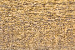 El tablero de madera de la textura pintó amarillo y anticuado para el momento en que fotografía de archivo libre de regalías