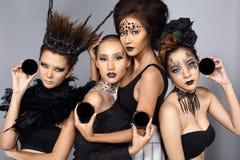 El talento creativo de lujo estilo compone y de pelo en el grupo de cuatro como foto de archivo libre de regalías