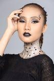 El talento creativo de lujo estilo compone y de pelo en hermoso asiático imagen de archivo