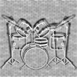 El tambor fijó contra el contexto de una pared de ladrillo Foto de archivo libre de regalías