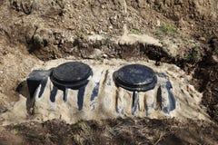 El tanque séptico en tierra Imagen de archivo