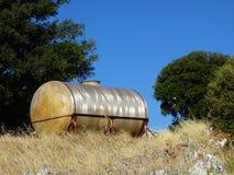 El tanque viejo del fuelóleo doméstico Foto de archivo libre de regalías