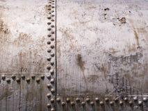 El tanque viejo del metal con los remaches Imagen de archivo libre de regalías