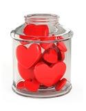 El tarro de cristal llenó de los corazones Foto de archivo libre de regalías