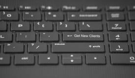 El teclado con consigue a nuevos clientes llave imagen de archivo libre de regalías