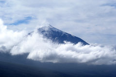 El Teide surrounded by clouds. Snowcapped vulcano El Teide surrounded by clouds Royalty Free Stock Photo