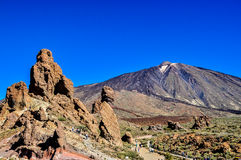 El Teide volcano, The Finger of God, Roques de Garcia and tourists Royalty Free Stock Photo