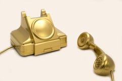 El teléfono del oro. Foto de archivo libre de regalías
