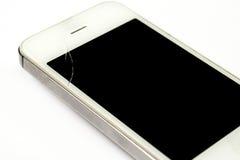 El teléfono elegante está quebrado en la pantalla Fotos de archivo