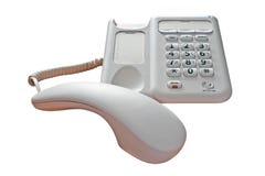 El teléfono invita al control aislado Foto de archivo
