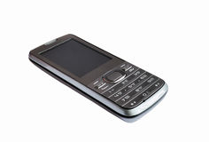 El teléfono móvil en un fondo blanco Imagen de archivo libre de regalías