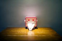 El tenedor del papel del pañuelo con la cara divertida Foto de archivo libre de regalías