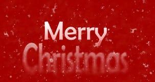 El texto de la Feliz Navidad da vuelta al polvo de la parte inferior en fondo rojo Imágenes de archivo libres de regalías