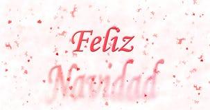 El texto de la Feliz Navidad en español Feliz Navidad da vuelta para sacar el polvo del franco Foto de archivo libre de regalías