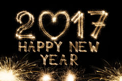 El texto del Año Nuevo, bengala numera en fondo negro Fotos de archivo