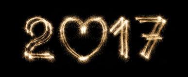 El texto del Año Nuevo, bengala numera en fondo negro Imagen de archivo libre de regalías