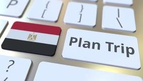 El texto del VIAJE del PLAN y la bandera de Egipto en el teclado de ordenador, viaje relacionaron la animación 3D libre illustration