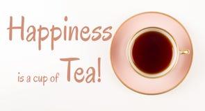 El tiempo del té cita, rosa hermoso y la taza del oro de té, tiro desde arriba, felicidad es taza de té, fotografía de archivo libre de regalías